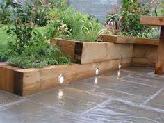 simple perimeter raised planters with pine sleepers raised