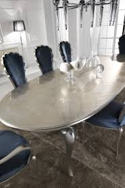 the silver leaf dining set including navy blue velvet chairs is a