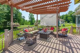 inviting backyard patio deck with pergola stock photo 479830810
