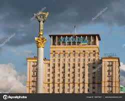 independence monument and hotel ukraina against stormy sky kiev