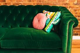 tufted velvet sofa green velvet tufted sofa and pink rug