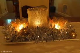 new years centerpiece candles tinsel ornaments mercury glass