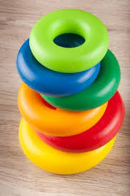 plastic rings images Pyramid of different size and color toy plastic rings on wooden jpg