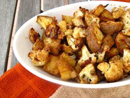 sweet potato thanksgiving side dish spicy baked cauliflower and sweet potatoes