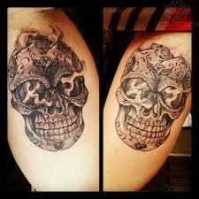 sugar skull tattoos on thigh