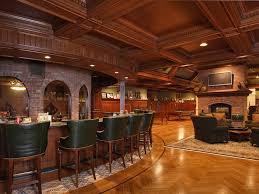 Wine Cellar Floor - traditional wine cellar with wainscoting u0026 herringbone tile floors