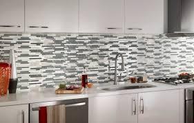 installing kitchen tile backsplash backsplash installation granite countertop teal cabinets kitchen