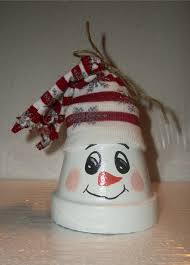 small clay pot snowman topped with christmas sock diy crafts
