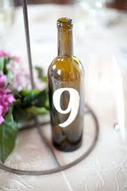 gold wine bottle table numbers montecito country club wedding by jenna marie photography xoxo