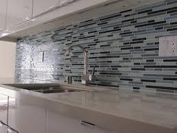 mosaic tile kitchen backsplash with white cabinets travertine