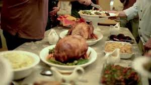 thanksgiving table with turkey thanksgiving table turkey side dishes man carving slicing and
