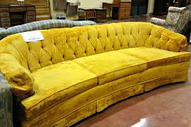 old and vintage yellow velvet tufted sofa with 3 cushions for