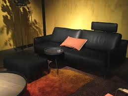 black leather sofa with orange pillows centerfieldbar com