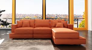 l brown leather floating couch with chaise on the floor of