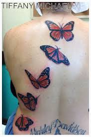 monarch butterfly running up the back tattoos i did