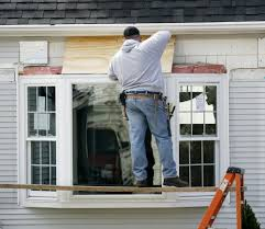 bay window compare window types now save with modernize a contractor installs a bay window into a home