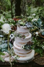 picture of wedding cake with succulents thistles and leaves
