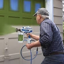 can you use a paint sprayer to paint kitchen cabinets how to paint a garage door using a paint sprayer graco