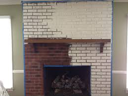 traditional brick wall painted fireplace with white color added
