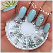 what about this pale blue gel nails with a triangle of gems on it
