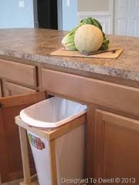 Kitchen Cabinet Trash Can Convert The Under Counter Space Behind A Single Kitchen Cabinet