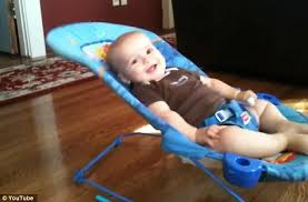 Baby Bouncing Chair Energetic Baby Shows Off His Strength In Bouncer Seat Daily Mail