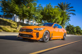 bright orange cars kia brings two modied stinger gt show cars to sema