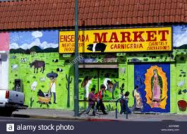 los angeles mural mexican stock photos los angeles mural mexican usa california los angeles chicano mexican family along painted wall of shop note the representation of