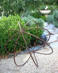 metal orb makes a striking garden feature metal wall garden