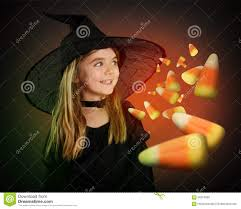 halloween costumes candy corn child witch waiting for halloween candy corn on black stock photo