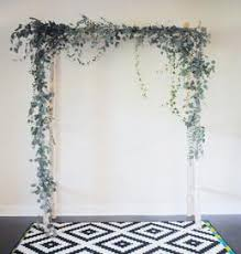 wedding arch leaves white birch wedding arch with eucalyptus and greens leaf