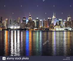 new york city manhattan midtown skyline at night with lights stock