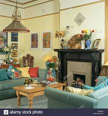 Pale Yellow Living Room by Blue Sofas And Pine Coffee Table In Pale Yellow Economy Style