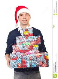 smiling man holding christmas gifts royalty free stock photography