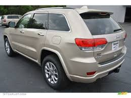 light brown jeep 2014 cashmere pearl jeep grand cherokee overland 4x4 79950237