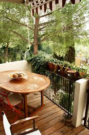 sweet small balcony ideas with metal black fences decorated with