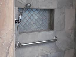 gray granite builtin shower shelf with glass inside over chrome