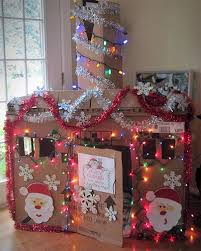kids could decorate their own smaller cardboard holiday house as
