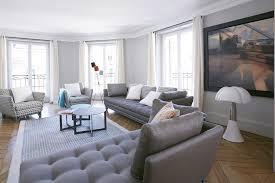 roche bobois canapé littoral grand salon moderne dans les tons gris bertille bosset