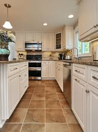 white kitchen cabinets with tile floor you seen a canterbury kitchen antique white