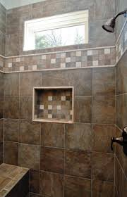 gorgeous dark brown custom tile walk in shower with a window and