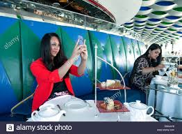 woman taking a selfie photo the skyview bar interior of the