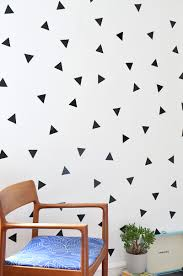 diy removable triangle wall decals burkatron be careful when you remove the decals from your walls when you want to change them just slowly peel them off i was gentle and not a scrap of paint came