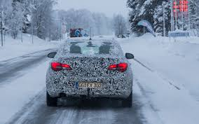 opel winter camouflaged opel astra sedan spotted should the buick verano get