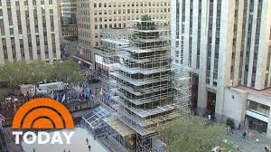 the 94 foot rockefeller center christmas tree arrives by truck