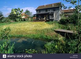Eco Friendly House by Eco Friendly House With Verandah Wild Flower Meadow Garden With