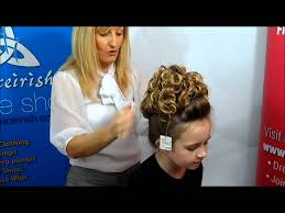 hairstyles for an irish dancing feis how to put on a caitlyn loose curl irish dancing bun wig youtube