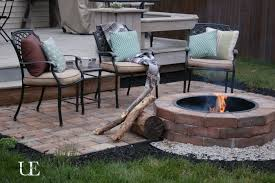 outstanding brick fire pit ideas with black iron chairs and