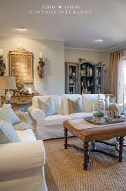 family room i love everything about this room white sofas family room i love everything about this room white sofas leather coffee table painted armoire filled with religious statues cream colors jut