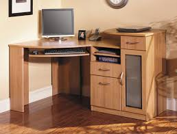 wood home office corner desk with keyboard tray and small cabinet